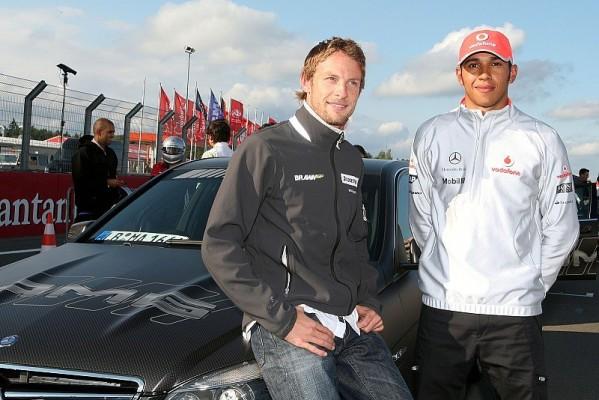 Button und Manager in Woking: Zwei Weltmeister für McLaren?