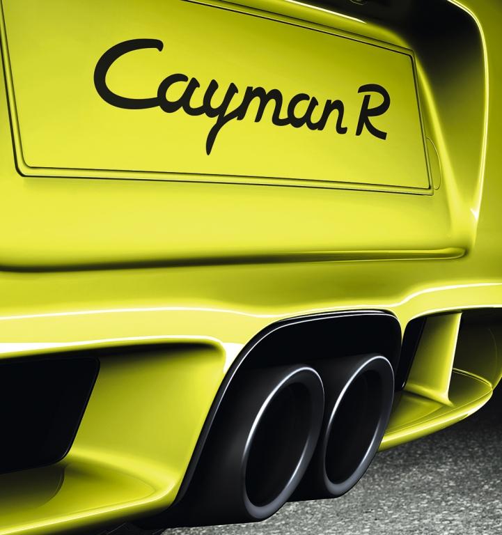 Porsche Cayman R: Heckansicht mit Doppelendrohr und Modellschriftzug.