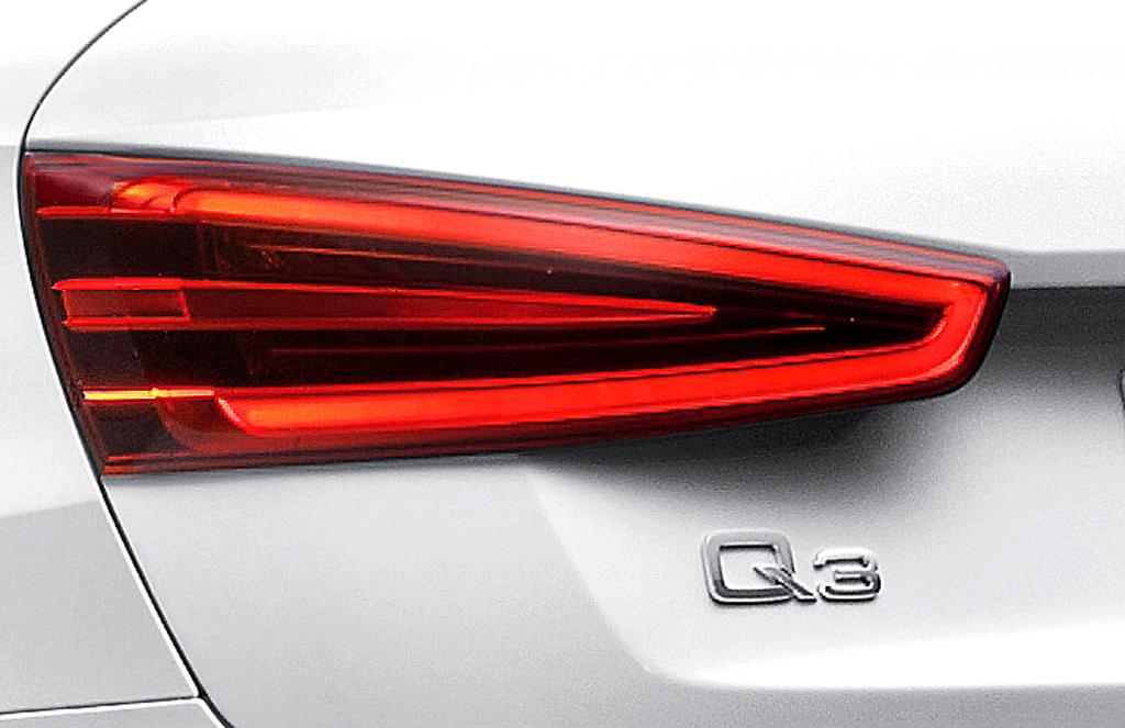 Audi Q3: Moderne Leuchteinheit hinten mit Modellschriftzug.
