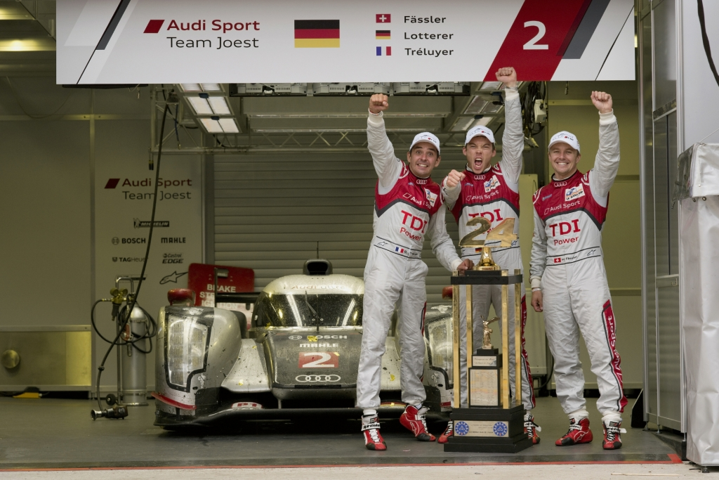 Die Sieger von Le Mans: Benoît Tréluyer, Marcel Fässler und André Lotterer.
