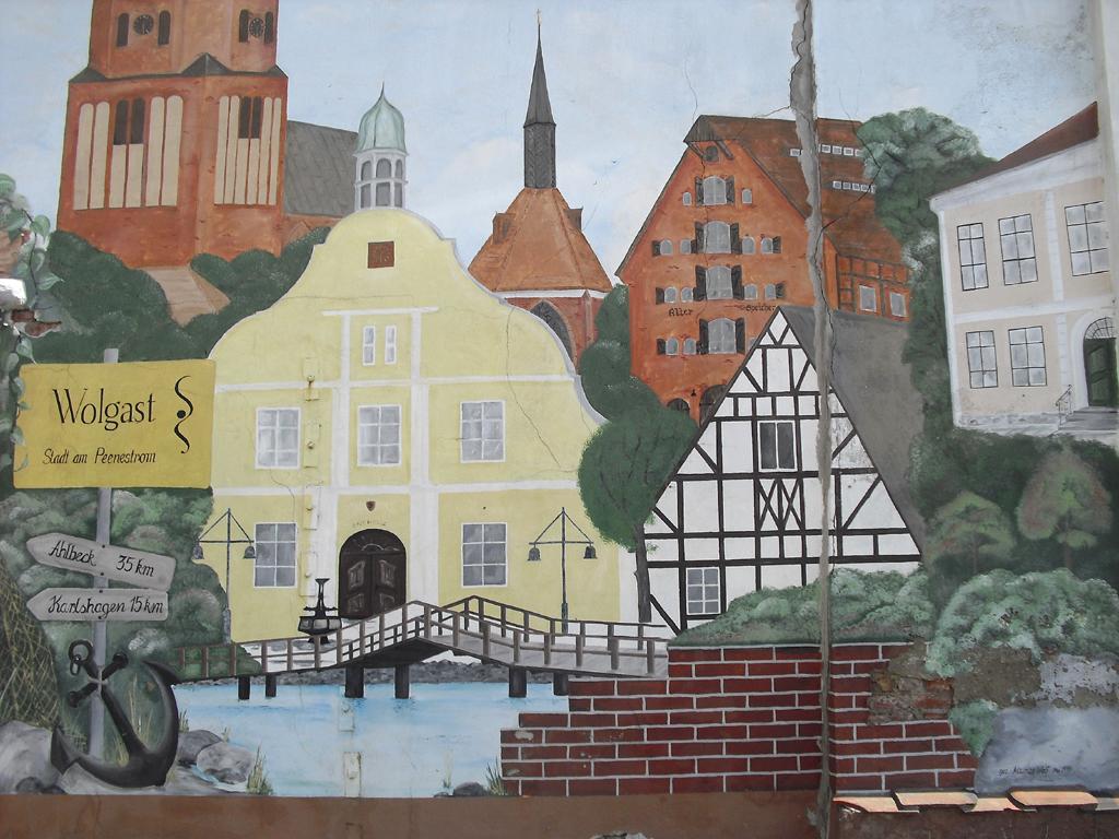 Buntes Hauswandgemälde in der Werftstadt Wolgast am Peenestrom.