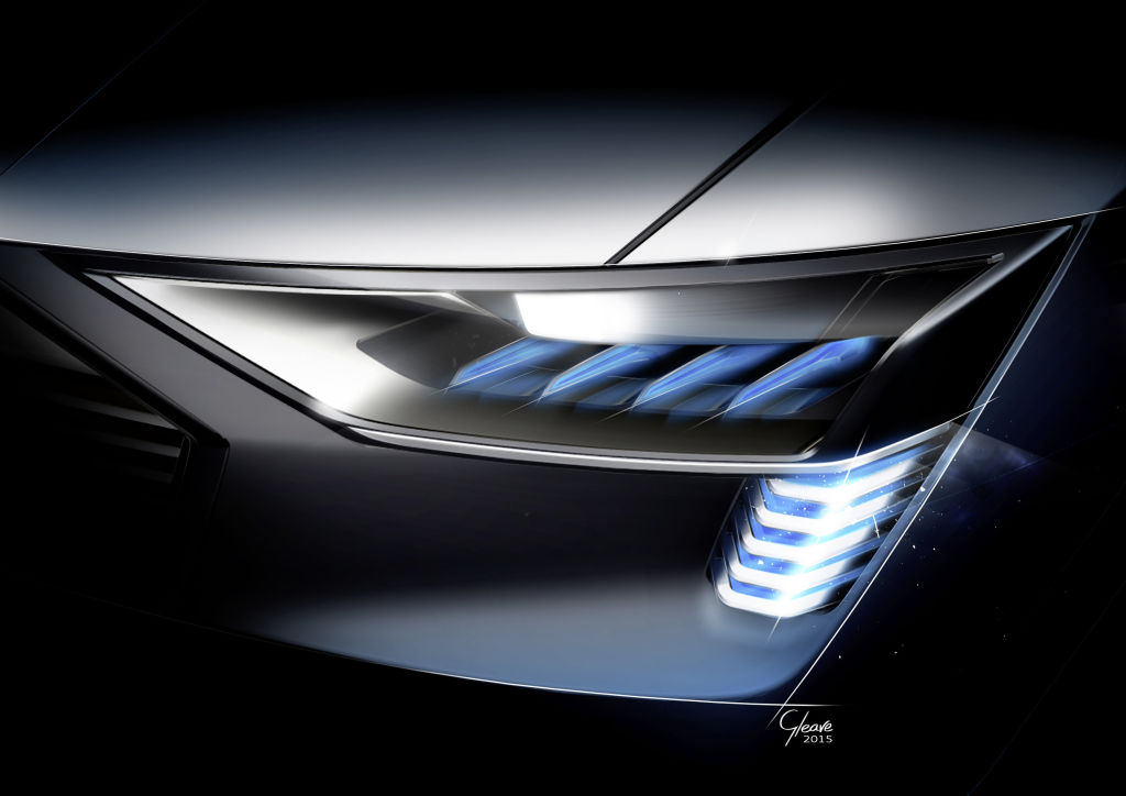 """The Audi e-tron quattro concept marks the world premiere of Matrix laser OLED technology at the front of a vehicle and epitomizes """"Vorsprung durch Technik"""" in the field of automotive lighting."""